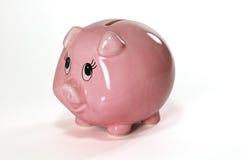 Banco Piggy & moeda de um centavo fotografia de stock royalty free
