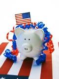 Banco piggy branco e azul vermelho Fotografia de Stock Royalty Free