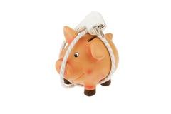 Banco Piggy com cabo e plugue de potência fotografia de stock royalty free