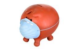 Banco Piggy com máscara protetora Imagem de Stock