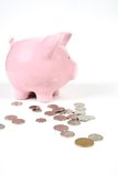 Banco Piggy cor-de-rosa no branco com Fotografia de Stock Royalty Free
