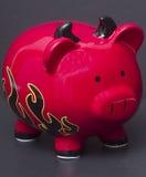 Banco Piggy de diabo vermelho imagem de stock royalty free