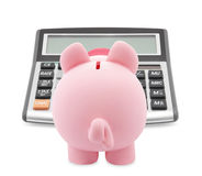 Banco Piggy e calculadora Imagens de Stock