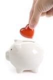 Banco Piggy e coração vermelho Fotografia de Stock Royalty Free