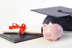 Banco Piggy e diploma Fotografia de Stock Royalty Free