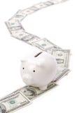 Banco Piggy e dólares Imagem de Stock