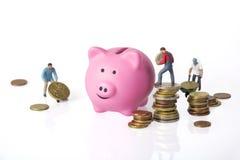 Banco Piggy e euro- moedas Fotos de Stock Royalty Free