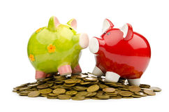 Banco Piggy e moedas Foto de Stock Royalty Free