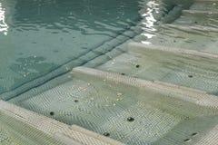 Banco subaquático da massagem da piscina interior fotografia de stock