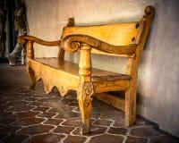 Banco tallado madera Fotografía de archivo