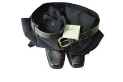 Banconota con la mutanda di affari e la scarpa nere della schiuma su fondo bianco Fotografia Stock