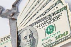 Banconota dei dollari dei tagli di forbici su bianco Fotografia Stock Libera da Diritti