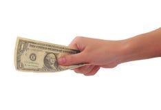 banconota del Un-dollaro in una mano Fotografia Stock Libera da Diritti