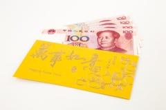 Banconota di yuan e busta dorata Fotografia Stock Libera da Diritti