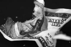 Banconota in dollari bruciante Fotografie Stock