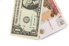 Banconota in dollari dell'americano 1 e 100 rubli russe Fotografia Stock