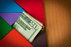 Banconota in dollari nel puzzle Immagini Stock Libere da Diritti