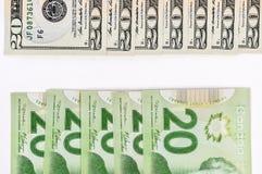 20 banconota in dollari Stati Uniti e canadese Fotografie Stock Libere da Diritti