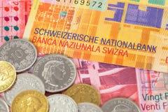 Banconota e monete del franco svizzero dei fondi della Svizzera Fotografie Stock