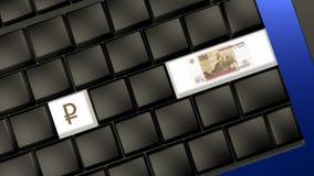 Banconota e segno della rublo russa sulla tastiera del computer portatile immagini stock