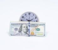 Banconota ed orologio del dollaro Fotografie Stock