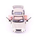 Banconota piegata nell'automobile di modello Fotografie Stock Libere da Diritti