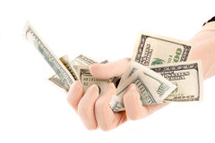 Banconote dei dollari della holding della mano Fotografie Stock