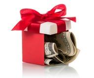 Banconote del dollaro in contenitore di regalo Fotografia Stock