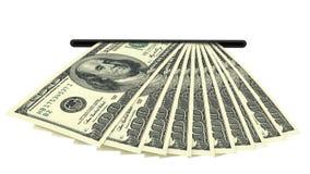 Banconote del dollaro in una scanalatura dei contanti Fotografia Stock Libera da Diritti