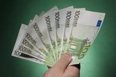 Banconote della tenuta della mano Fotografie Stock