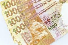 Banconote di valuta sparse attraverso il dollaro di Hong Kong della struttura fotografia stock libera da diritti