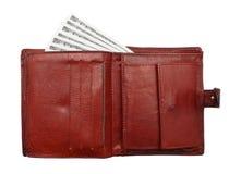 100 banconote in dollari dalla borsa. Fotografie Stock