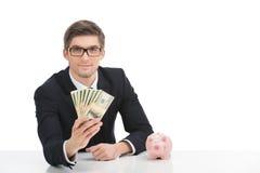 Banconote in dollari della tenuta dell'uomo di affari, su bianco Fotografie Stock