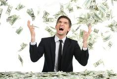 Banconote in dollari ed urlo di lancio dell'uomo di affari Fotografie Stock Libere da Diritti