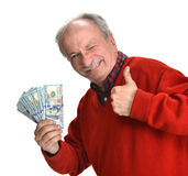 Banconote in dollari fortunate della tenuta dell'uomo anziano Fotografia Stock