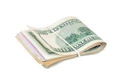 Banconote in dollari legate con un elastico Immagine Stock