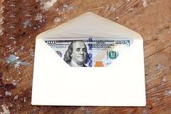 Banconote in dollari o soldi con la busta Fotografia Stock