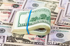 Banconote in dollari piegate Immagini Stock