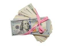 100 banconote in dollari in un nastro del regalo Fotografie Stock