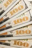 Banconote in dollari unite smazzate dello stato cento Fotografia Stock