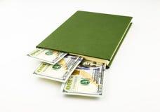 Banconote e libro dei soldi del dollaro Fotografie Stock Libere da Diritti