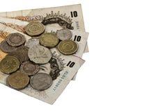 Banconote e monete Immagini Stock