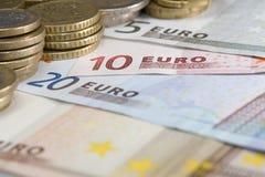 Banconote e monete Fotografie Stock Libere da Diritti