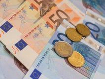 Banconote e monete Fotografie Stock