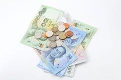 Banconote e monete di baht tailandese Fotografia Stock