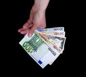 Banconote femminili dell'euro e del dollaro della tenuta della mano Fotografie Stock