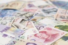 Banconote internazionali di valute Fotografie Stock