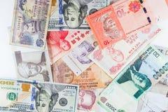 Banconote multiple di valute come fondo variopinto Fotografie Stock