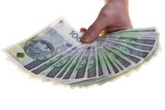 Banconote polacche di valuta cento zloty impilate a disposizione Fotografia Stock Libera da Diritti