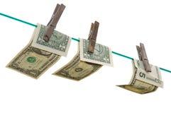 Banconote su una riga di vestiti Fotografia Stock Libera da Diritti